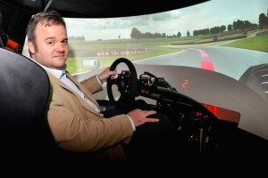 Tim Luft in one of woote's patented virtual reality driving simulator pods