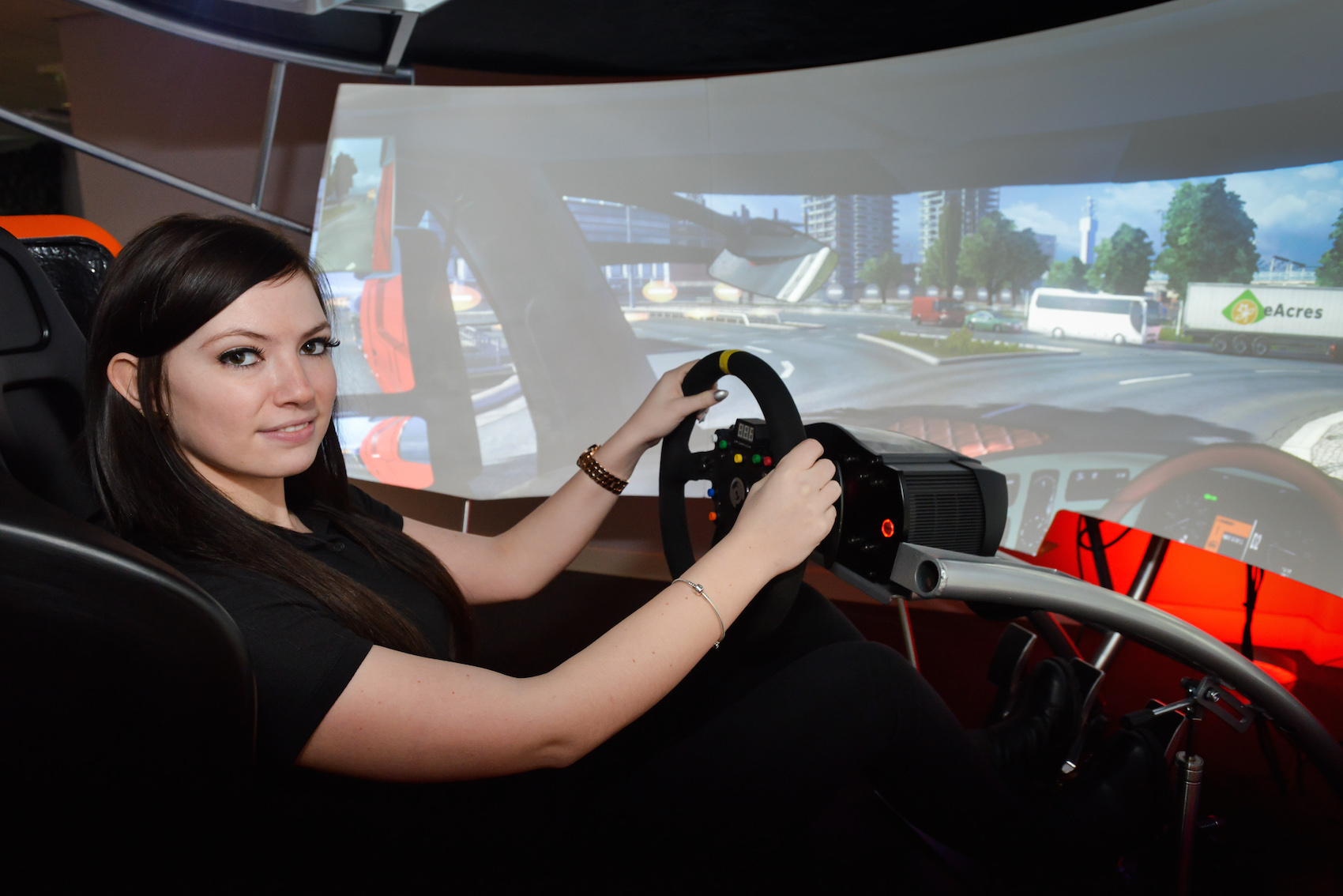 At the wheel of a woote virtual reality driving simulator