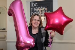 Kim Carr, Managing Partner of FBC Manby Bowdler, celebrates the firm's success in the Best Companies to Work For awards.
